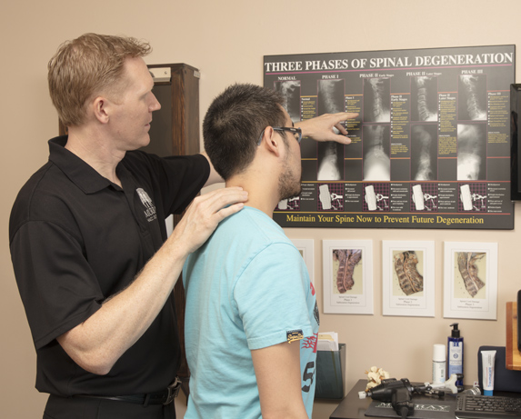 Dr. Rob showing a the three phases of Spinal degeneration