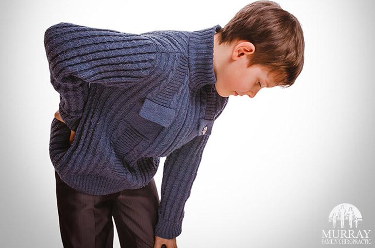 Image of a kid who is having back issues